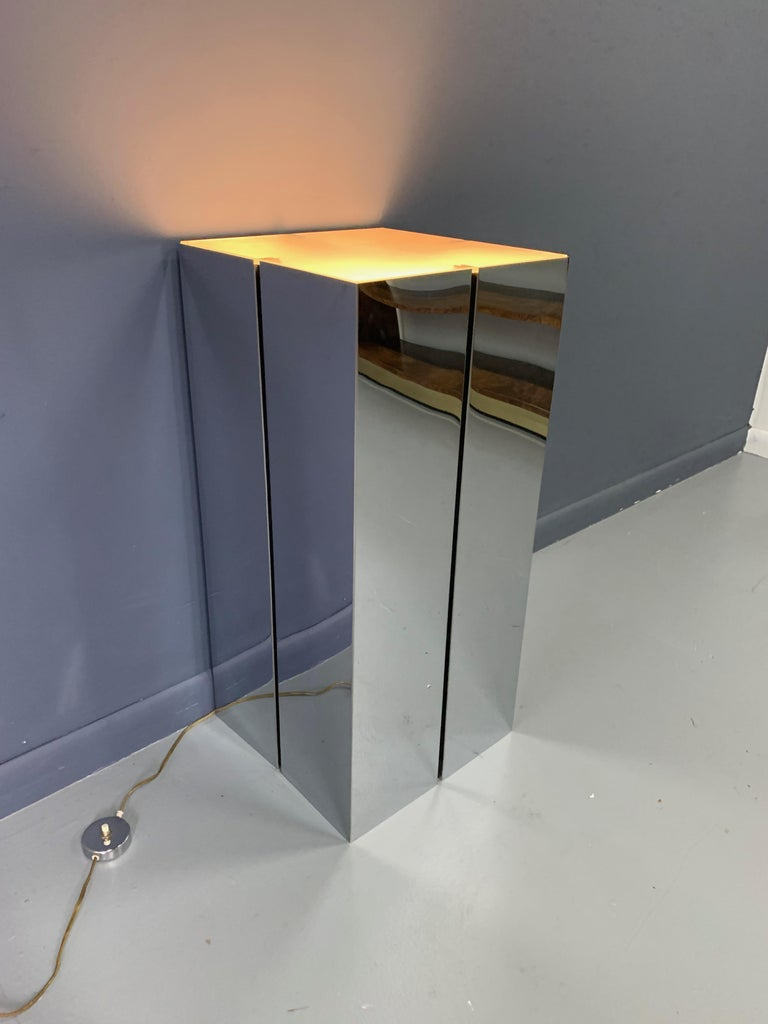 Chromed steel illuminated pedestal with frosted glass top designed by Neal Small for George Kovacs.