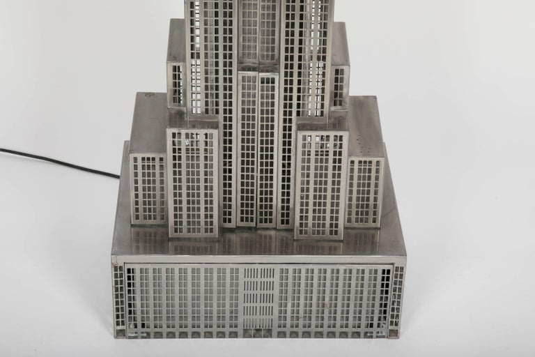 A, one-of-a-kind lighted steel sculpture of the Empire State Building signed with a Little Dipper.