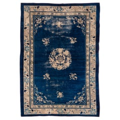 Lightly Distressed Antique Chinese Rug, Blue Filed