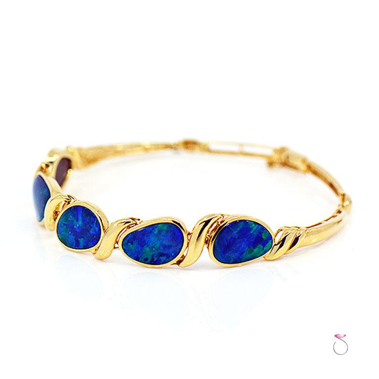 Modern Lightning Ridge Black Opal Sectional Bracelet 14 Karat Yellow Gold For Sale