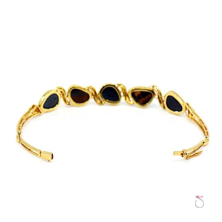 Lightning Ridge Black Opal Sectional Bracelet 14 Karat Yellow Gold In New Condition For Sale In Honolulu, HI