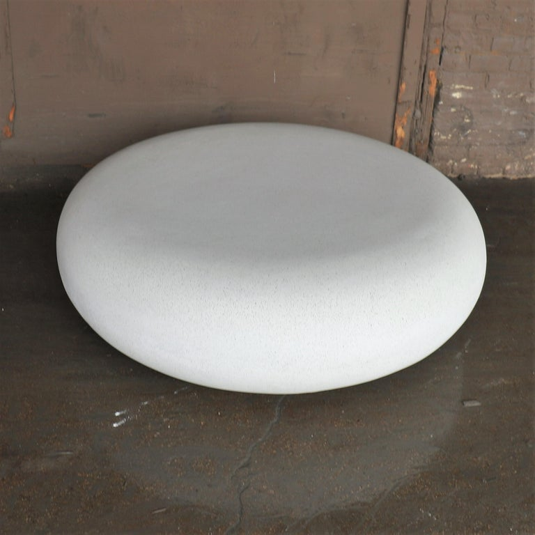 """The pebble table is an elegant cocktail table with an organic form. Pictured in our white stone finish, the texture and modern look of concrete make it appropriate for a wide variety of styles and spaces.  The pebble table (ZBT416) is 48"""" in"""