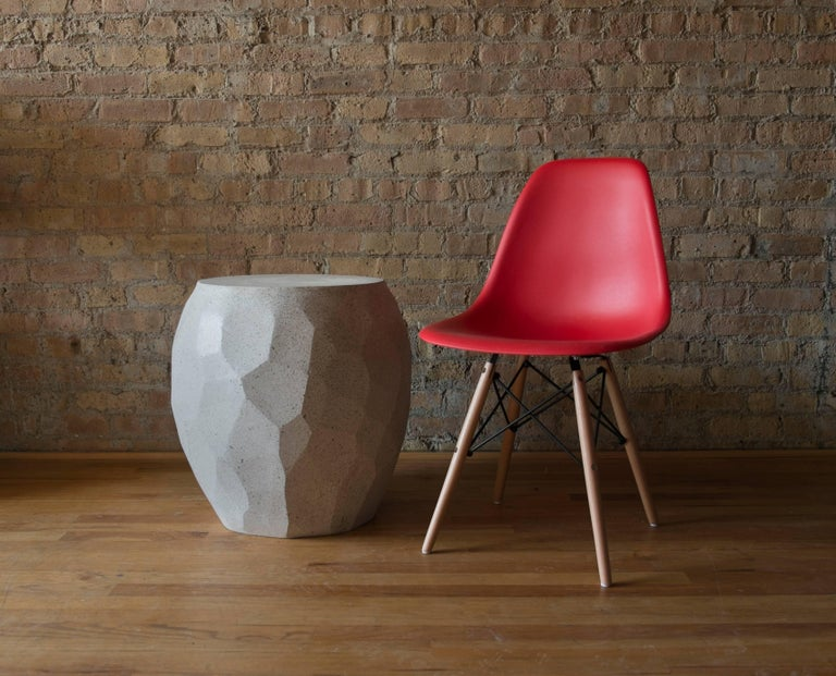 The Facet side table can be used as both a stool or side table. Pictured in our Natural Stone finish, the texture and modern look of concrete make it appropriate for a wide variety of styles and spaces.  The Facet table (ZBT225) is 20