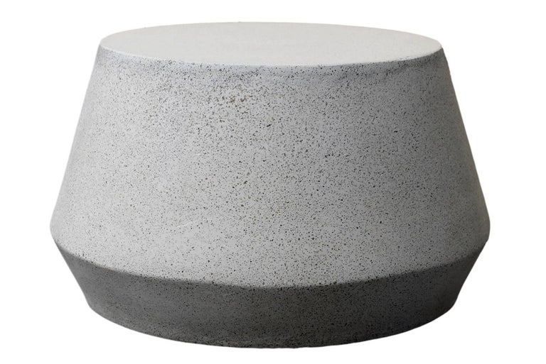 The Tom table is perfect as a coffee or cocktail table, indoors and out. Pictured in our natural stone finish, the texture and modern look of concrete make it appropriate for a wide variety of styles and spaces.  The Tom table (ZBT232) is 24