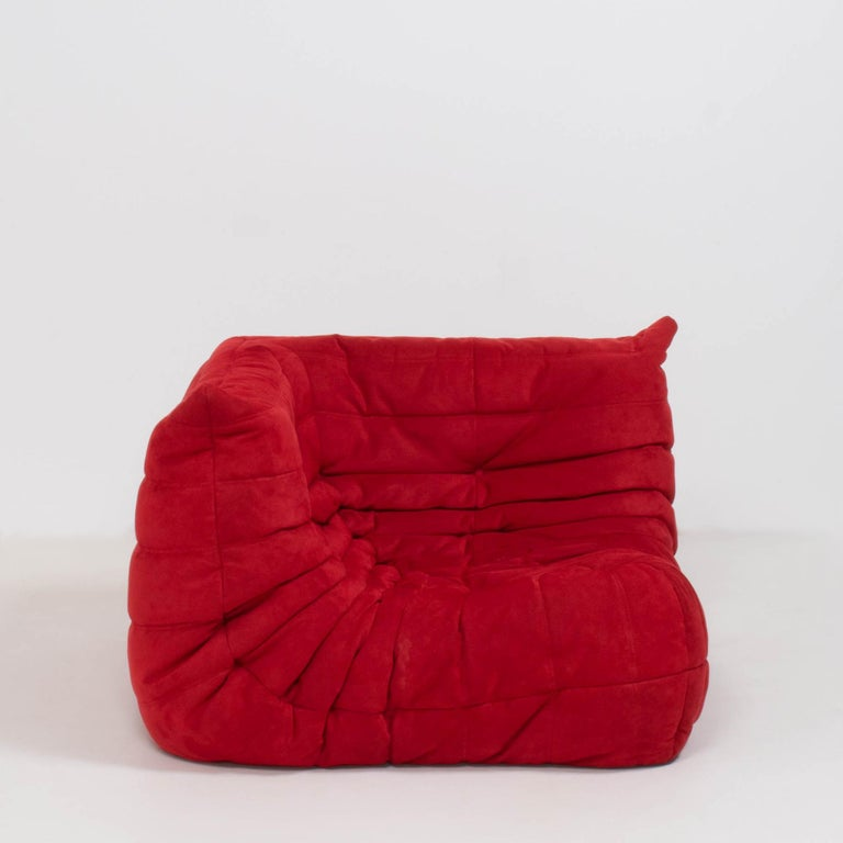 The iconic Togo sofa, originally designed by Michel Ducaroy for Ligne Roset in 1973 has become a design Classic.  The corner seat features the original red suede upholstery and the instantly recognizable pleated fabric design, which gives the sofa