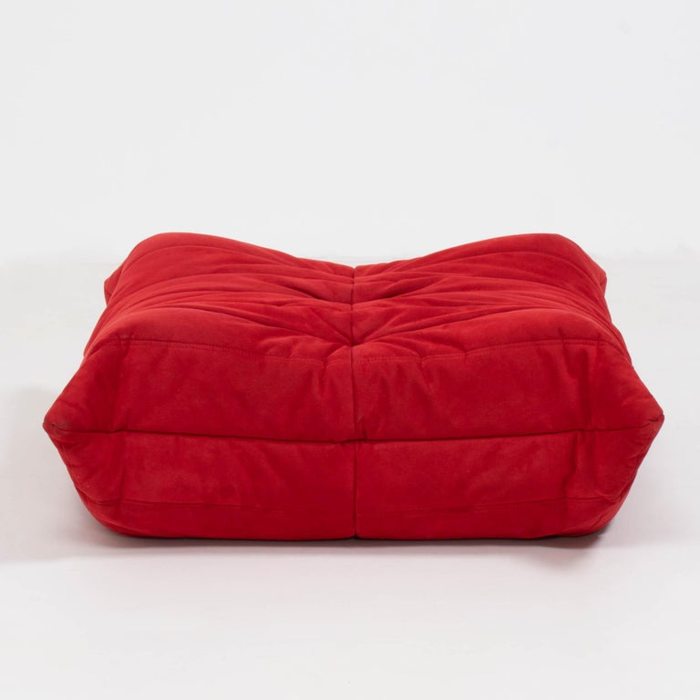 The iconic Togo sofa, originally designed by Michel Ducaroy for Ligne Roset in 1973 has become a design Classic.  The footstool features the original red suede upholstery and the instantly recognizable pleated fabric design, which gives the sofa