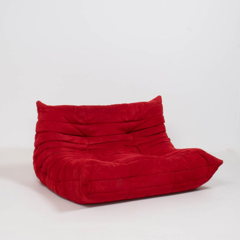 The iconic Togo sofa, originally designed by Michel Ducaroy for Ligne Roset in 1973 has become a design Classic.  The sofa features the original red suede upholstery and the instantly recognizable pleated fabric design, which gives the sofa its