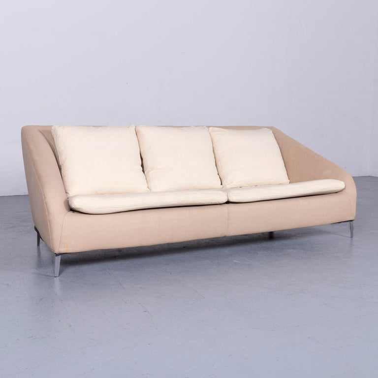 We bring to you an Ligne Roset designer fabric sofa brown beige three-seat couch.