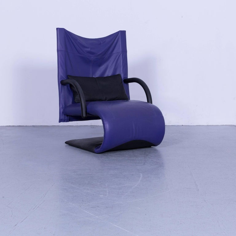 We bring to you a Ligne Roset leather armchair violet one-seat swing-chair.