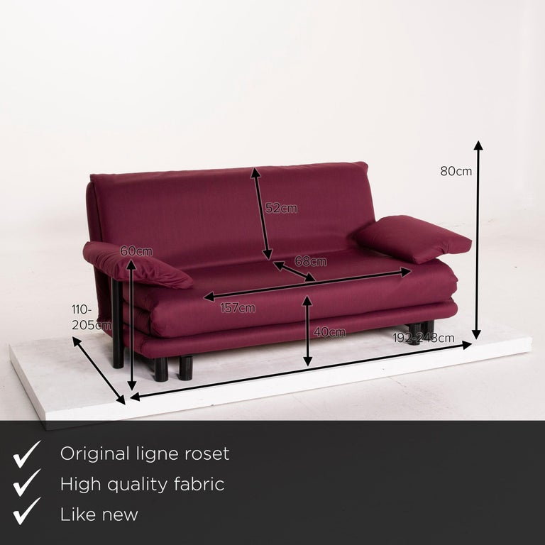 We present to you a Ligne Roset Multy fabric sofa purple three-seat sleeping function.      Product measurements in centimetres:     depth: 110  width: 192  height: 80  seat height: 40  rest height: 60  seat depth: 68  seat width: 157