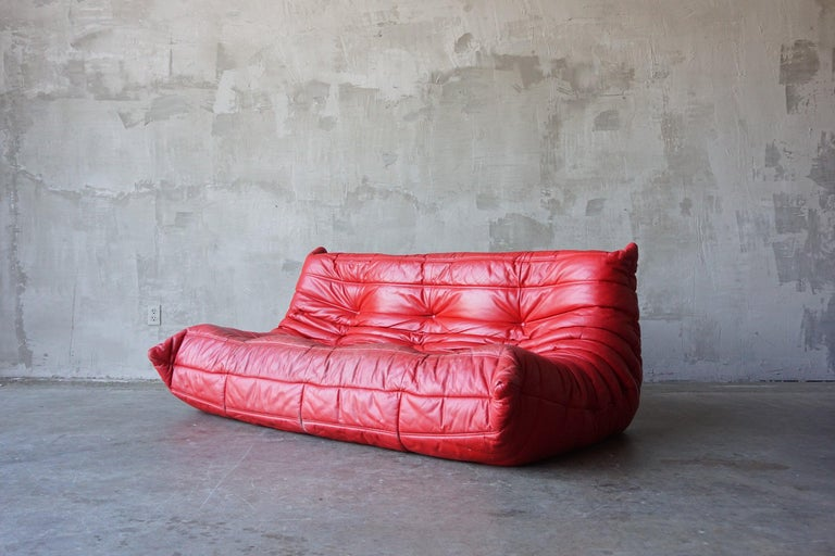 Stunning vintage 'Togo' sofa in lipstick red leather designed by Michel Ducaroy for Ligne Roset, circa 1970s. 