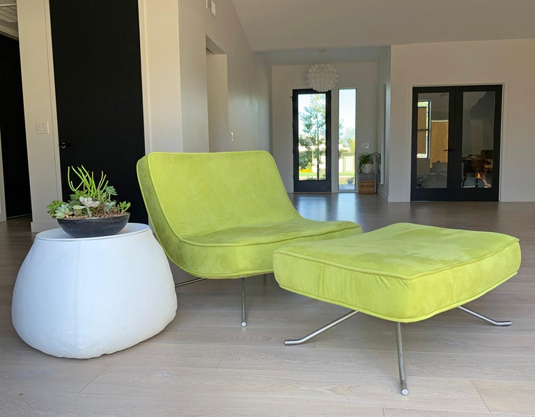 An absolutely stunning chair designed by Christian Werener for Ligne Roset, 2001. This lime green Pop Chair and ottoman feature curvy, clean lines with a modern feel. This transitional lounge chair would look incredible in almost any environment as