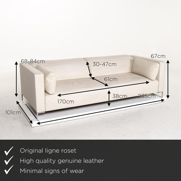 We present to you a Ligne Roset Urbani leather sofa cream three-seat couch.    Product measurements in centimeters:    Depth 101 Width 235 Height 68 Seat height 38 Rest height 67 Seat depth 61 Seat width 170 Back height 30.