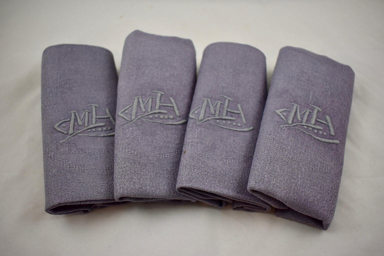 A set of four French Provençal linen serviettes, showing a hand-embroidered monogram, circa late 1890s-early 1900s.