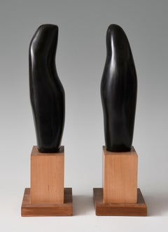 Sinuous Dance, sculpture of two abstracted figures, black marble with wood base