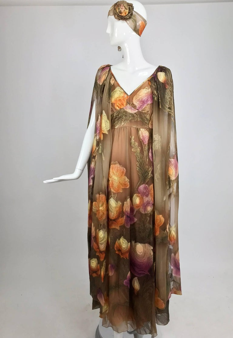 Lilija Nicis hand painted metallic silk chiffon gown from the 1960s. Lilija Nicis made specialty clothing for wealthy clients in the 1950s and 60's at her shop in Rockville Centre New York, she was listed as a couturier and the quality of her