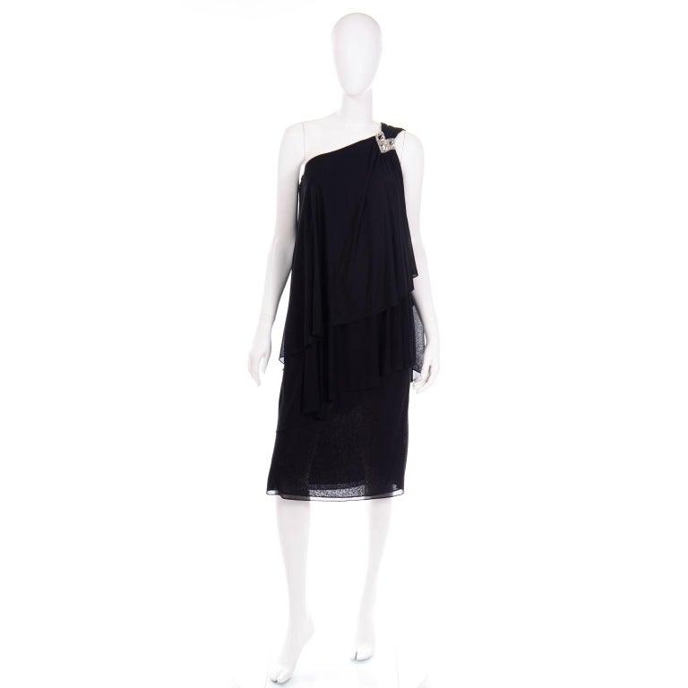 This is a Grecian style vintage 1970's Lilli Diamond black evening dress with one shoulder rhinestone detail. This pretty dress has several layers of the same semi sheer black silky lightweight jersey fabric with varying lengths in the layers. There