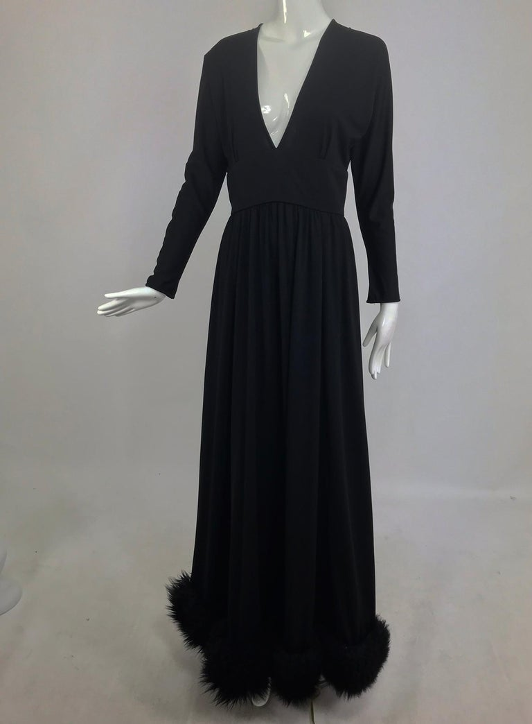 Lillie Rubin black fur hem plunge neck black jersey maxi dress from the 1970s. This amazing dress will get you noticed every time. The bodice has a plunge V neckline and the back also features a deep V, the sleeves are dolman and taper at the wrist