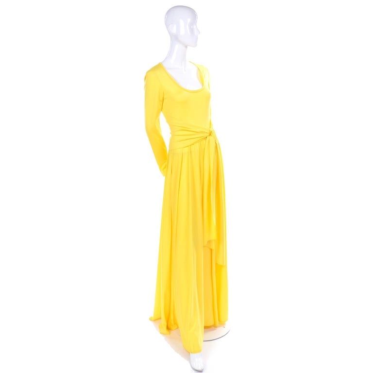 This is a lovely 1970's sunny yellow vintage maxi dress from Lillie Rubin. The jersey dress has a self sash and closes with a back zipper.  The bodice is fitted, with a scoop neck, and the skirt is voluminous and moves beautifully when worn. The