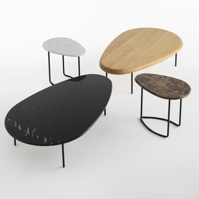 The concept of customization is at the basis of the Lily Collection of tables designed by Marc Thorpe, inspired by the shape of the flowering plant Nymphaeaceae. Available with fabric, wood, and marble tops, the featured table has a striking black