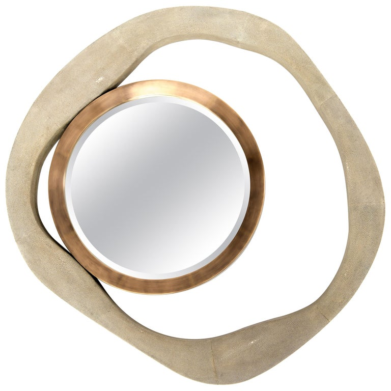 The Lily mirror by R&Y Augousti in black shagreen and bronze-patina brass, is an iconic piece of theirs and is an extremely versatile mirror. Due to the fixtures at the back this piece can be hung in three different ways creating a different