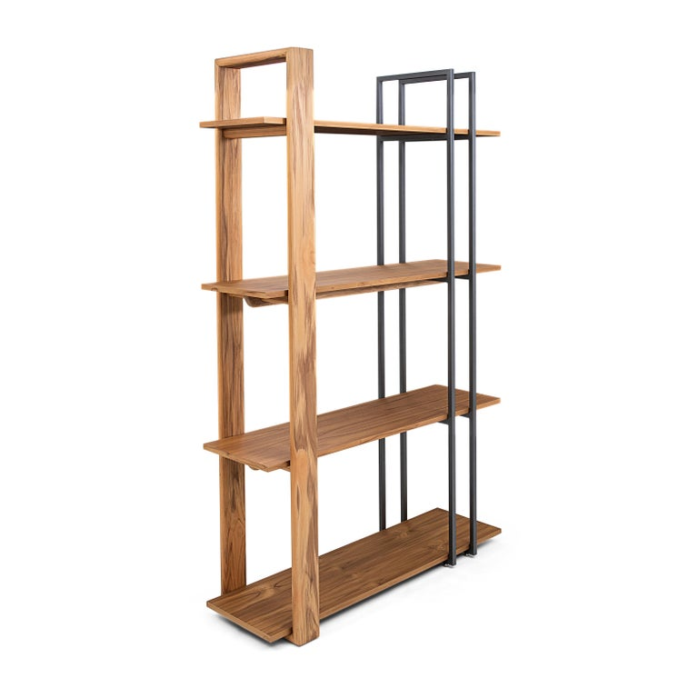 The Lim bookcase features mixed materials and is stocked in both teak and walnut. The design, functionality, and size allow the Lim to be a statement piece wherever you need to locate it. Showpiece, bookcase, storage, etc. Lim is a great addition to