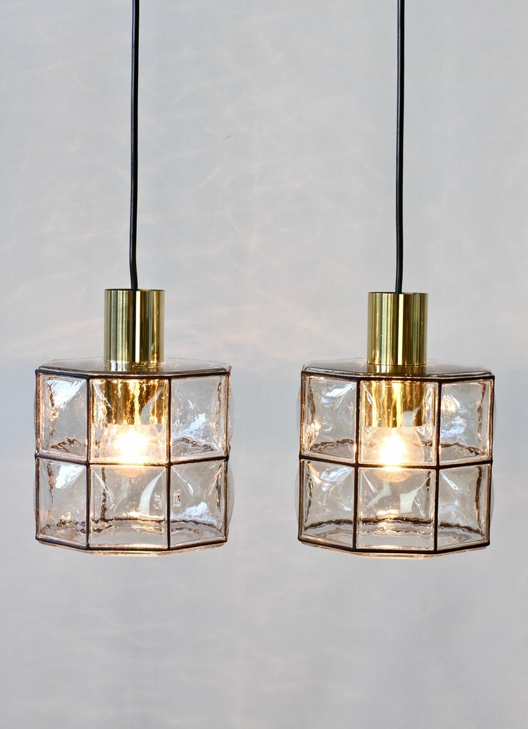 Limburg Glashutte minimal, geometric and simply shaped pendant lamp or light fixtures made in Germany, circa 1965. The Pulegoso or 'bubble' glass bulges slightly out of the black