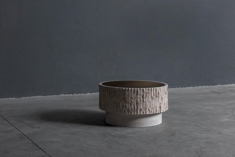 Limestone andbrass sculpted coffee table by Frederic Saulou Large coffee table Magny Limestone, patinated brass Measures: H 34, D 60 cm Limited edition of 12 Title: Ambigue Signed and numbered.
