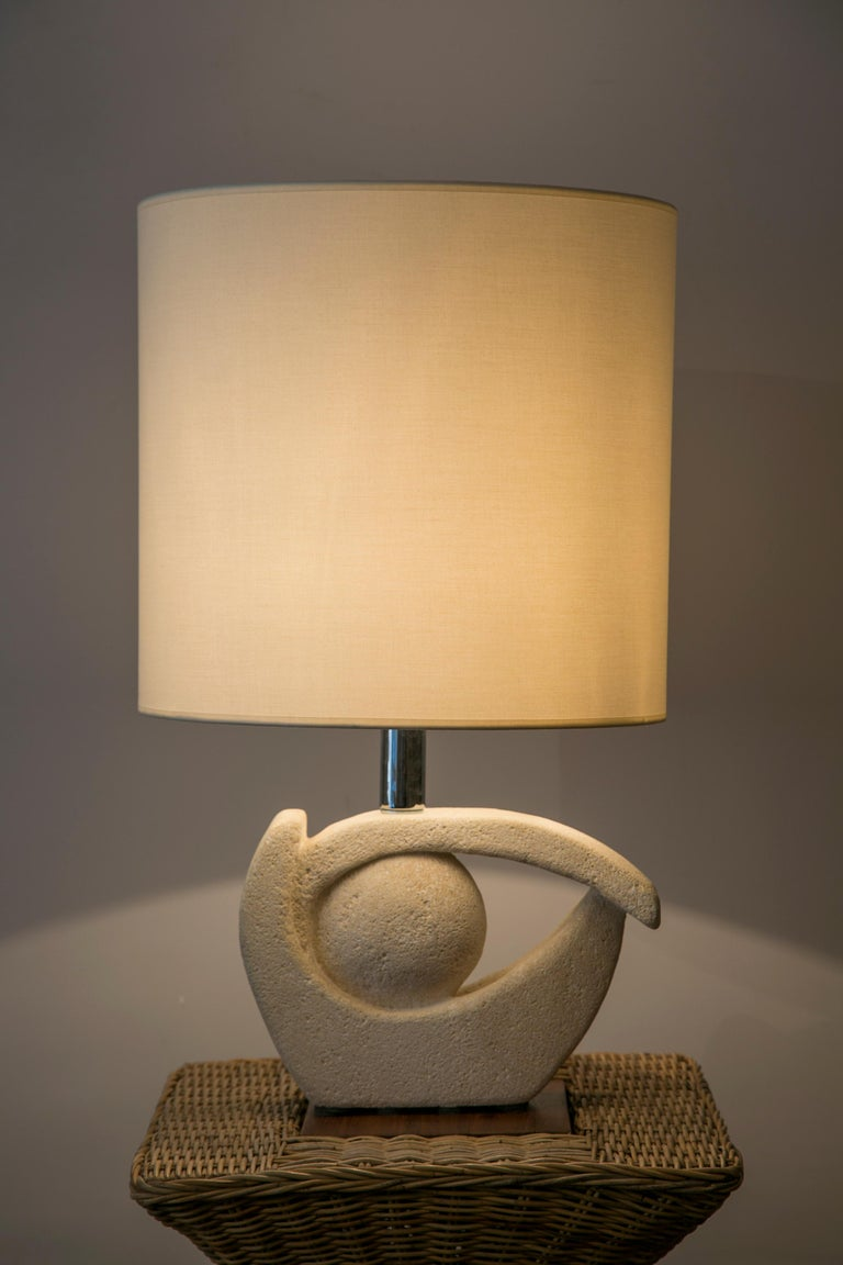 Table Lamp in Limestone by Albert Tormos signed : AT St Tropez, France, 1970s  Dimensions :  Height total : 63 cm ( 24.8 in.) Height base : 29 cm ( 11.4 in.) Width base : 30 cm ( 11.8 in.) Depth Base : 10 cm ( 3.9 in.)  Height shade : 36