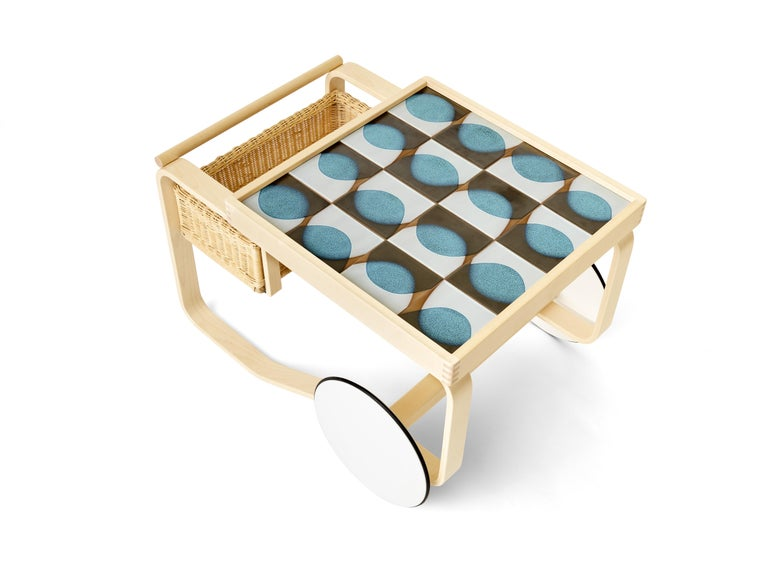 Experimental glazes from the 1940s meet innovative wood-bending techniques from the 1930s for a distinctive, memorable collection. As an edition of six designs with only six of each made, the iconic Artek tea trolley is inlaid with tile inspired by
