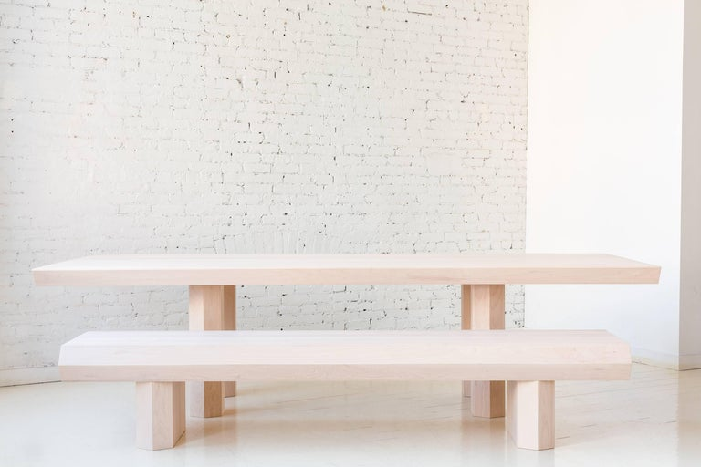 """A part of Fort Standard's """"Qualities of Material"""" collection, the Assemblage bench is made from hundreds of thin, hard maple wood slats. The slats are assembled into triangular tubes used to create the hollow top surface and hexagonal legs, which"""