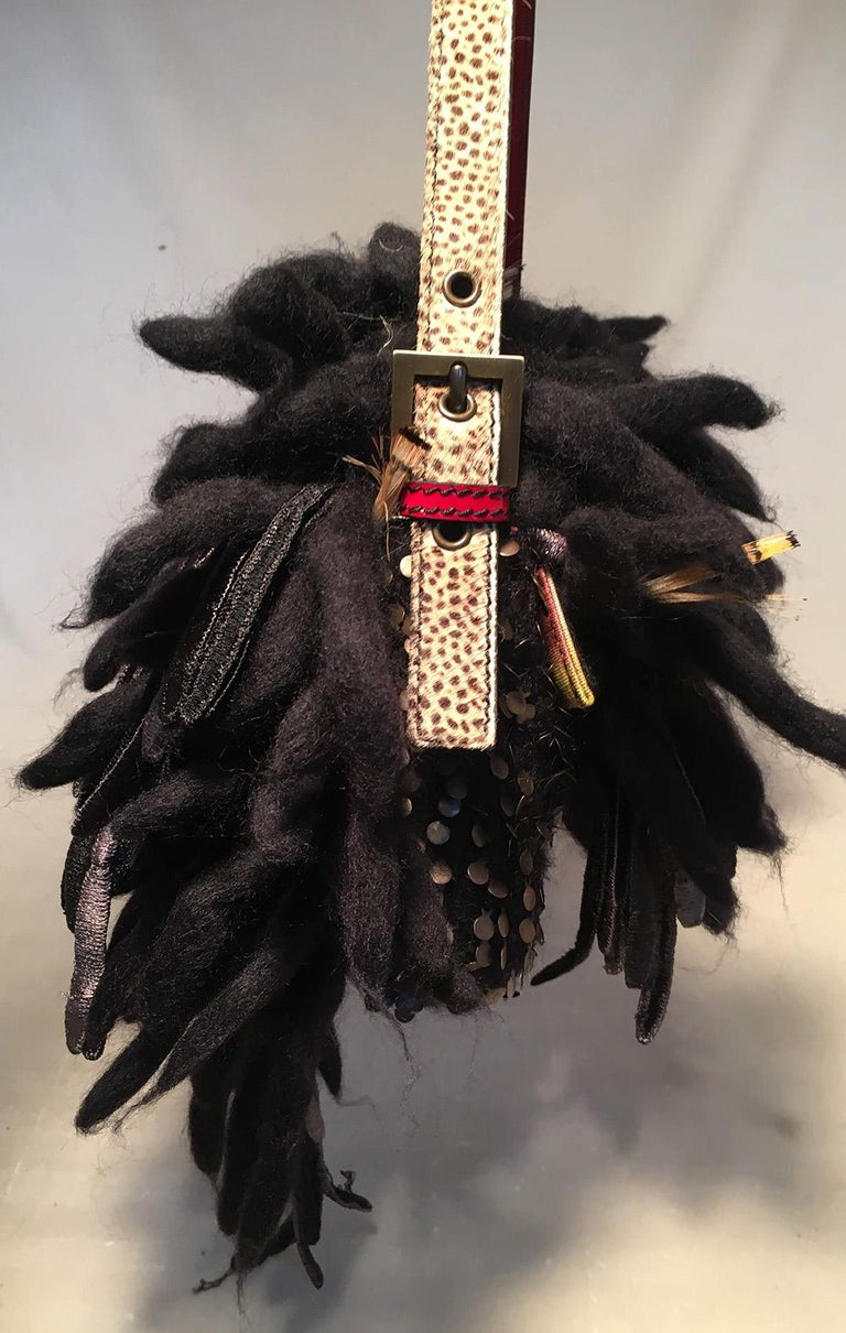 Limited Edition Fendi for Neiman Marcus Dreadlock Bird Baguette in excellent condition. To commemorate Neimans 100 year anniversary, Fendi produced 44 of these limited edition pieces. Each piece was handmade by the Fendi craftsmans and features a