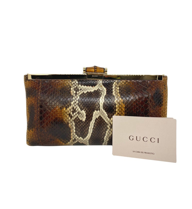 Extremely Rare Limited Edition Gucci Tom Ford Python Minaudière Runway Frame Bag. Making it's debut on the Spring Summer 2000 Gucci Runway under Tom Ford's creative direction, this one of a kind Gucci bag is like no other. This Python frame bag is