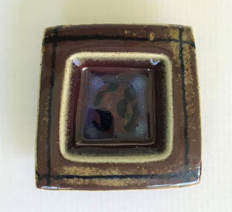 Bertil Lundgren for Rorstrand, Sweden beautiful midcentury Swedish modernist stoneware wall plaque/deep dish with an uneven square shape and hand painted in browns and blue underglaze glossy glaze. Created in the 1970s during Lundgren tenure at