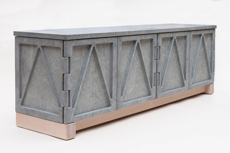 """A part of the """"Qualities of Material"""" collection, this stone credenza has a triangular relief pattern milled into the exterior panels, which removes excess weight and allows the remaining ribs to retain the material's strength. The soapstone cabinet"""