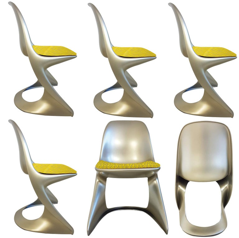 Unusual set of Ostergaard polyethylene in lacquered metallic color made by rotational molding fixed (indoor/outdoor use) chairs with new seats made of geometric woven jacquard textile fabric