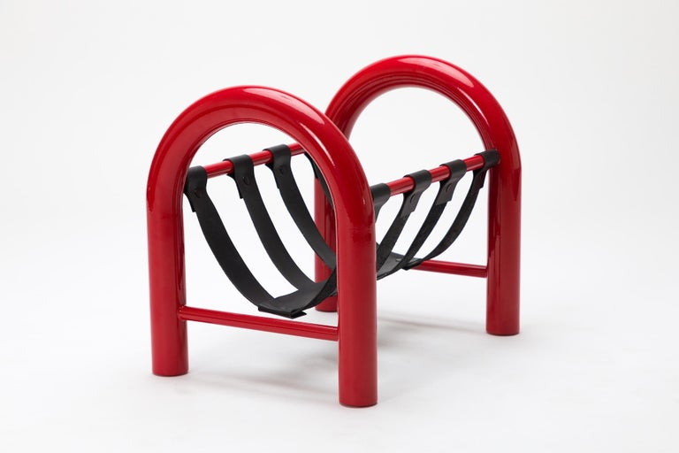 The tubular magazine rack is a lightweight yet durable magazine rack perfect for holding any reading materials you want at the ready, while injecting a sense of thoughtful design into a space.  This limited edition red frame with black leather