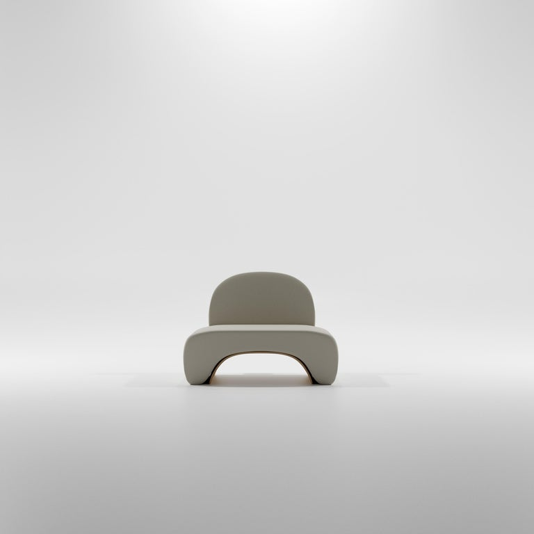 21st Century Collectible modern organic brutalist style design chair finished in smooth cement produced with bespoke pigmentation upon request.