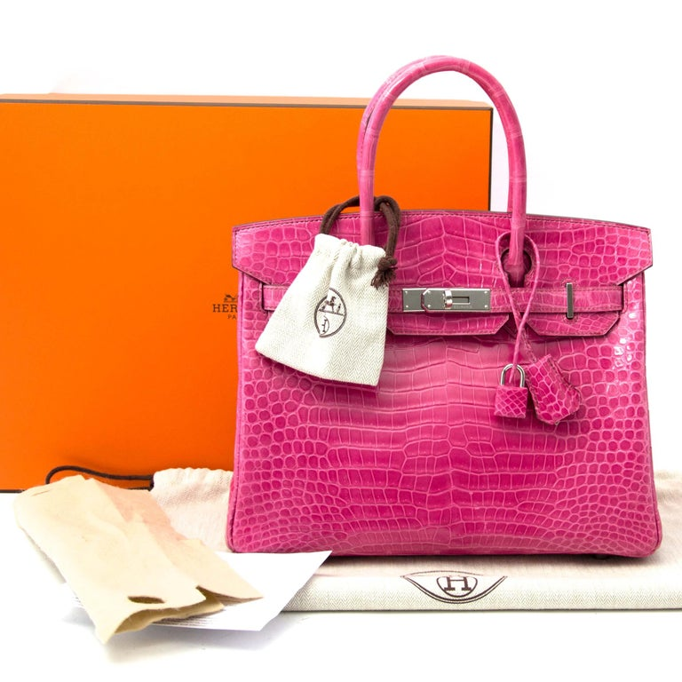 Very hard to find Hermès Birkin 30 Croco Porosus Lisse Fuchsia PHW  This extremely hard to find Hermès Birkin 30 Croco Porosus comes in a beautifull Lisse Fuchsia color.  Its stunning fuchsia hue is the perfect shade of pink. Porosus skin has fine