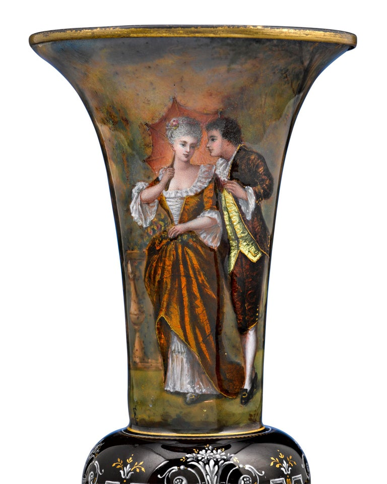 A gorgeous pair of Limoges enamel vases featuring romantic scenes of 18th century lovers in vividly colored dress. It is especially rare to find pairs of these wonderful vases in such pristine condition,  circa 1870.  Size: 7 3/4