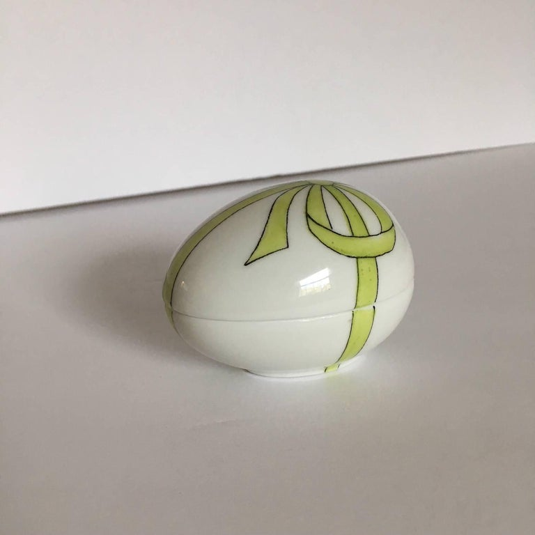 Delightful French Limoges white egg shaped box, decorated with a green ribbon and bow by Chamart Limoges. Perfect for a Mother's Day gift, or for the Limoge collector. From a large estate collection of Limoges boxes.
