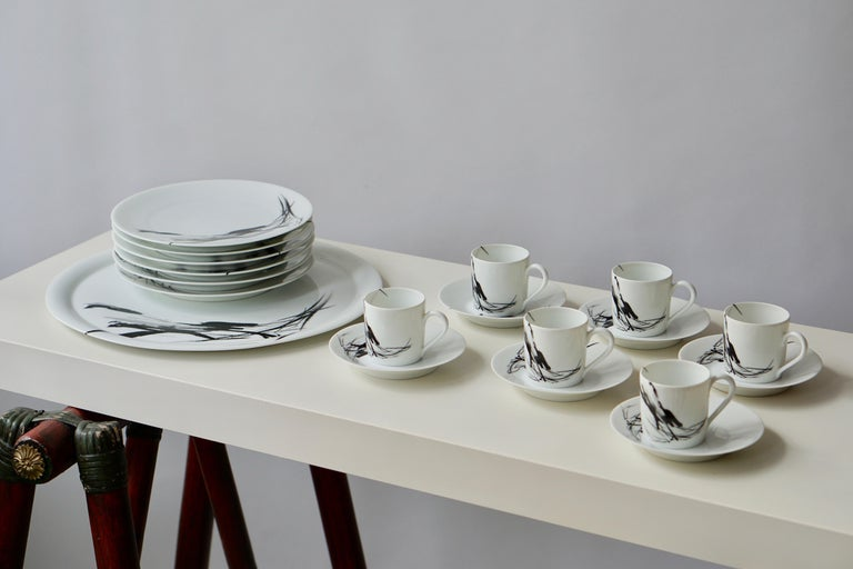 A Pierre Cardin Limoges porcelain tea and coffee service. Signed Limoges Lafarge, Pierre Cardin. It includes: Six coffee-cups and saucers with handles. Height cups 6 cm. Diameter 5 cm. Six pastry dishes. Diameter 19 cm. One pastry dish.