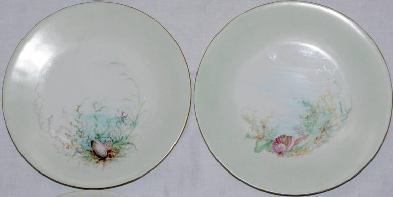We are offering a fabulous set of six dinner plates with a variety of seashell scenes. Two of the plates are signed on the back by M.H. Dismukes and dated 1898. The perimeter of the plates are tinted a soft green and the edges are rimmed in gold.
