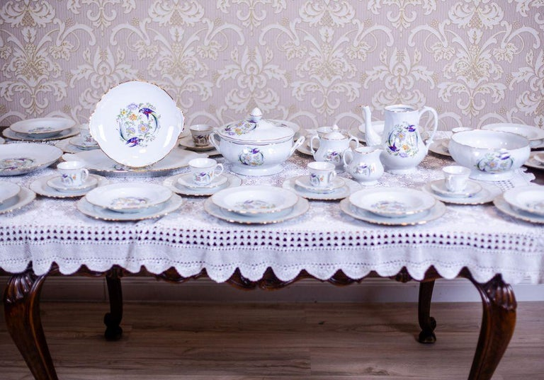 We present you a porcelain service, circa the 1970s-1980s, manufactured by Limonges in France. The porcelain is white, smooth; with wavy, gilded edges, and an original, multicolored pattern with the motif of paradise birds.  This great