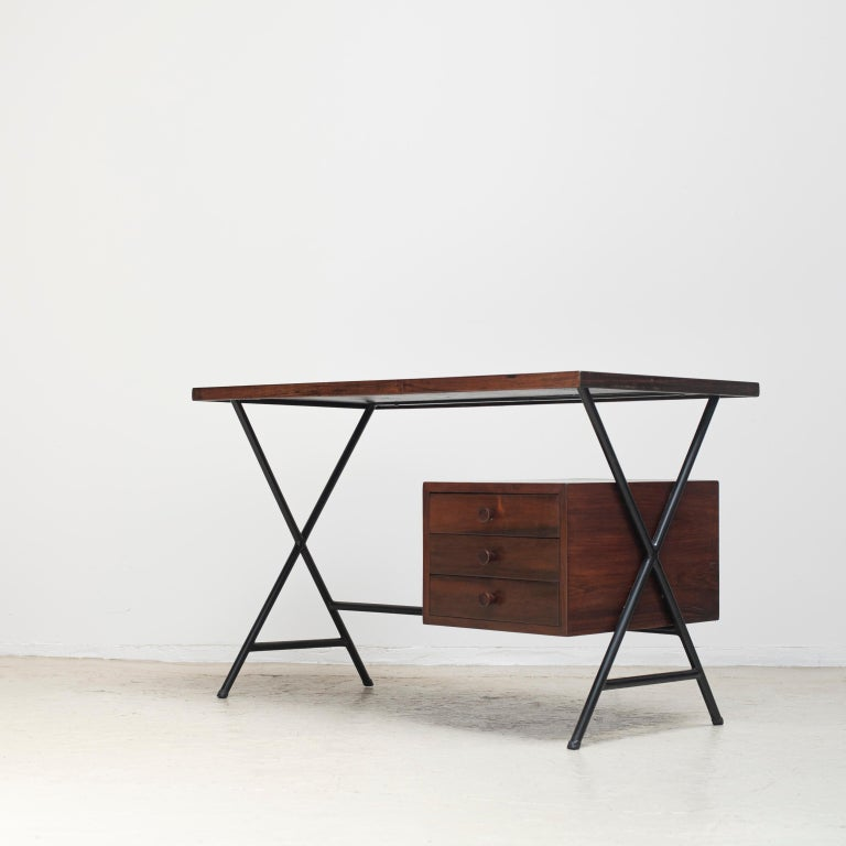 Writing desk designed by Lina Bo Bardi and Giancarlo Palanti for Studio d'Arte Parma in 1949. Made with rosewood and lacquered steel.