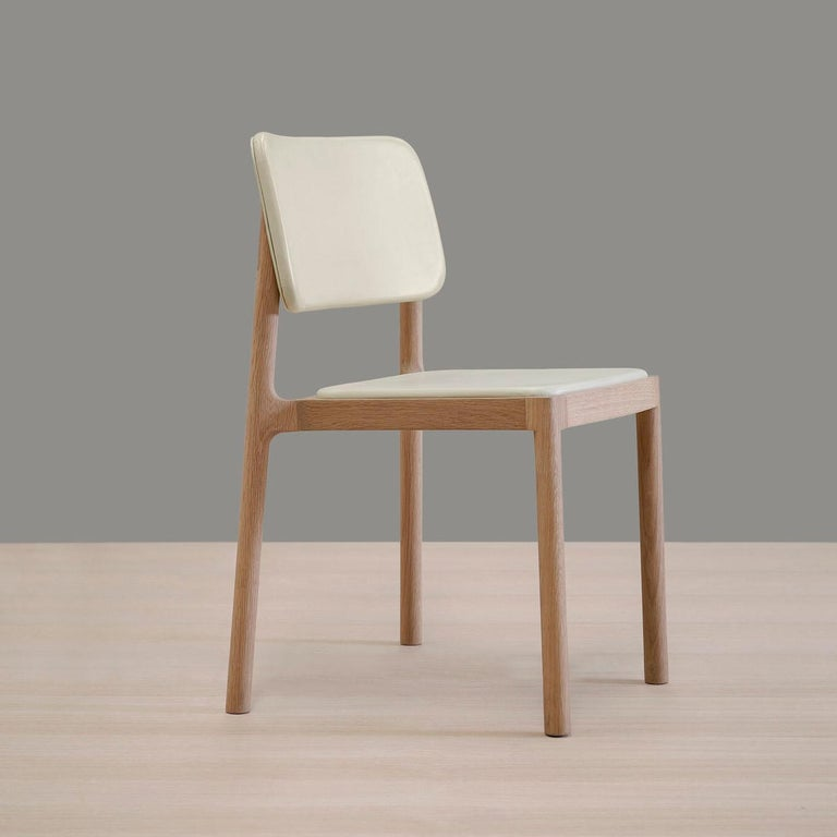 'Linard, oak and white leather chair was designed by Thai Hua for BREUER ESTUDIO. This piece is part of Linard y Gerard collection in which Thai collaborated with BREUER to create exceptional pieces.  Thai Hua is a Vietnamese industrial designer