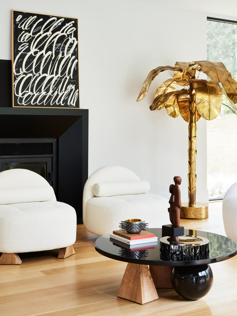 Made to order wood coffee table designed by Christian Siriano.  Top: Black lacquered maple Legs: Black lacquered maple, natural maple, stained maple.