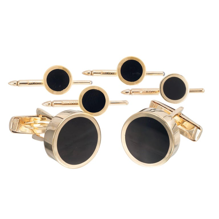 Classic black onyx and 14k yellow gold cufflink and complete shirt stud set   2 round black onyx slices 13.45mm 4 round black onyx slices 7mm 14k yellow gold Stamped: 14k Hallmark: Lindsay 27.4 grams Top to bottom: 15.95mm or 5/8 Inch Width: 15.9mm