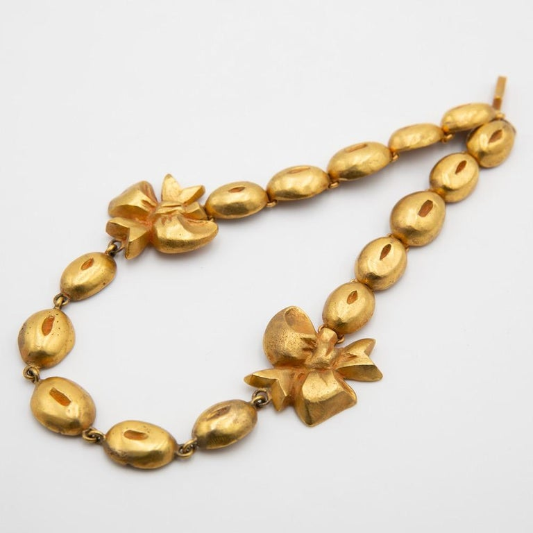 A gilded bronze necklace by Line Vautrin. Flowers and coffee beans.  Thank you for checking our inventory. We are specialized in European decorative arts. With an emphasis on Line Vautrin, old Murano glassware (Venini, Barovier, Dino Martens) but