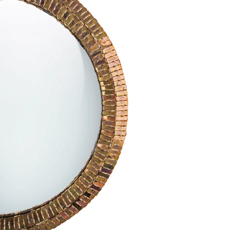 A large size convex mirror by Line Vautrin France. Convex central mirror. Gold - bronze incrusted mirrors on talosel structure. The back of the construction consists of a heel, which give the impression the mirror is